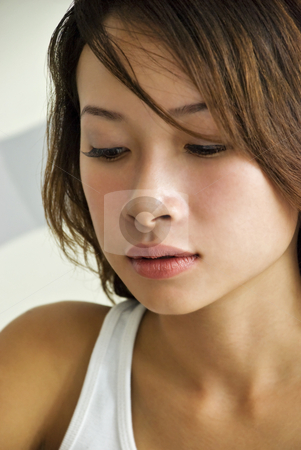 Sad Girl stock photo, A beautiful young Asian woman looking sad by Stefan Breton