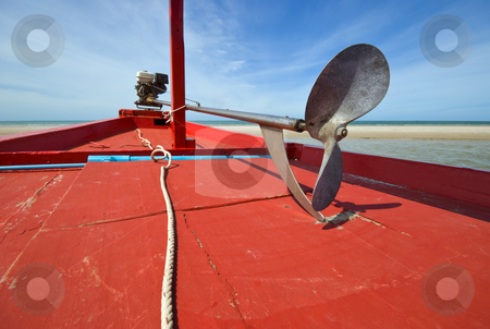 Red Fishing Boat stock photo, The propeller of red wooden fishing boat on the beach by Stefan Breton