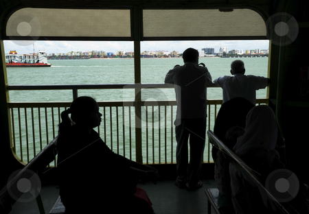 People on a Ferry stock photo, Silhouetted passengers on a ferry boat. by Stefan Breton