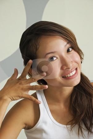 Beautiful Asian Lady Smiling stock photo, A beautiful young Asian lady smiling by Stefan Breton