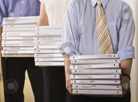 Business People Holding Binders stock photo, A group of business people are holding binders in an office.  Horizontally framed shot. by Jonathan Ross