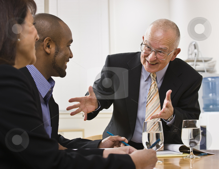 Business team meeting stock photo, Business team meeting with two men and a woman sitting at a desk with water.  Horizontal by Jonathan Ross