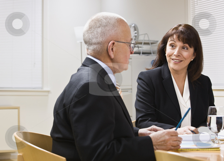 Business meeting stock photo, Business meeting with senior male and attractive female at desk. Horizontal by Jonathan Ross