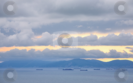 Ships, facing the harbor stock photo, Ships, facing the harbor, on the horizon, in the evening by Valery Kraynov