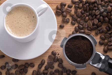 Composition with a cup of coffee and filter holder. stock photo, Cup of cappuccino with filter holder and coffee beans. by Valery Kraynov