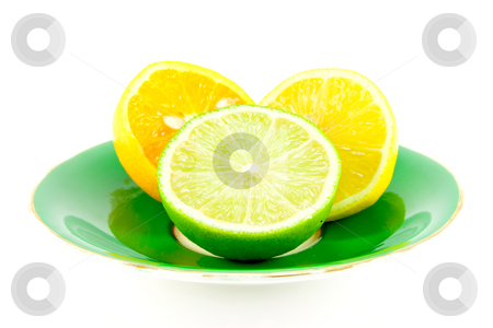 Citrus Halves stock photo, Lemon, lime and orange halves on a fancy green plate on a white background by Keith Wilson