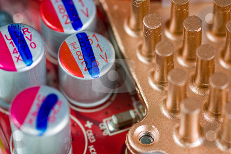 Computer transistors stock photo, Close up of computer expansion card with transistors and copper cooling surface by Gabriele Mesaglio