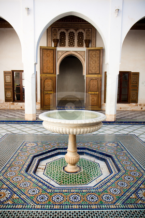 Moroccan mosaic floor and wooden door stock photo, Ancient mosaic floor and carved wooden door in Marrakech, Morocco. by Wouter Roesems