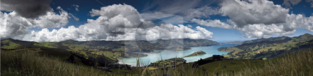Peninsular panorama stock photo, A 5 shot panorama of Banks Peninsular in New Zealand's South Island. Once the site of two large volcanoes, the sea eventually broke through the Caldera wall to form the wonderful harbour by Robin Ducker