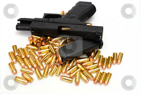 Black Handgun And Bullets stock photo, A semi automatic pistol with an extra 10 round magazine, and many .40 caliber brass cartridges. The weapon is locked open showing a cartridge ready to enter the chamber. by Lynn Bendickson