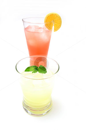 Pink And Yellow Lemonade stock photo, Two glasses of lemonade, one pink and the other yellow with a slice of lemon and a sprig of mint leaf. by Lynn Bendickson