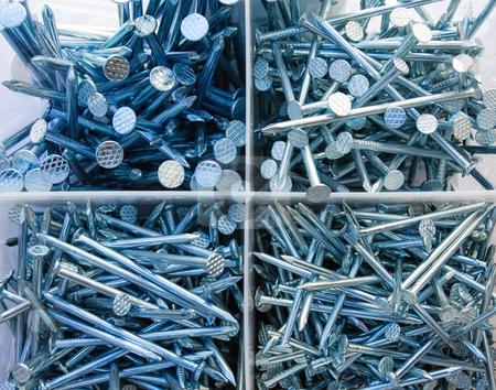 Nails stock photo, Closeup view of the many nails. by Sinisa Botas