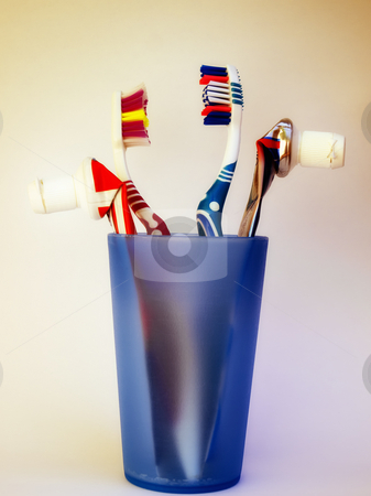 Everyday equipment stock photo, Used brushes and toothpaste represent everyday hygiene. by Sinisa Botas