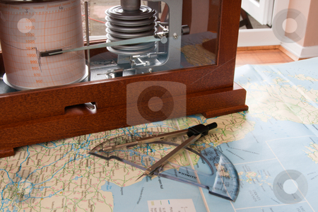 Barograph on a Map stock photo, Barograph in a wooden box standing on a map by Keith Wilson