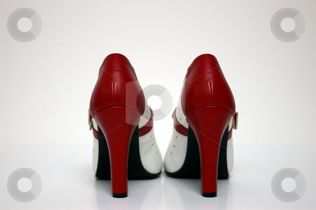 High Heel stock photo, An end view of a red and white high heel on white. by Tom Weatherhead