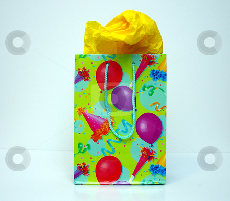 Gift bag stock photo, A gift bag for celebrations, Christmas or birthday gifts with tissue paper sticking out. by Tom Weatherhead