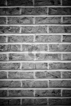Brick Wall Background stock photo, Brick wall background in black and white with vignetting. by Todd Arena