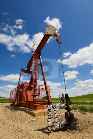 Pump jack stock photo, Oil field pump jack on the prairie by Steve Mcsweeny