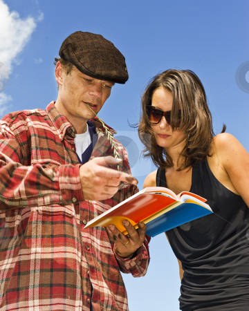 Tour guide stock photo, Local farmer acting as a temporary tour guid, explaining the sights to a smartly dressed beautiful young woman by Corepics VOF