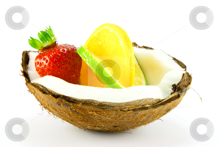 Strawberry,Lemon and Lime in a Coconut stock photo, Single red strawberry,lemon and lime slice in half a coconut with a white background by Keith Wilson