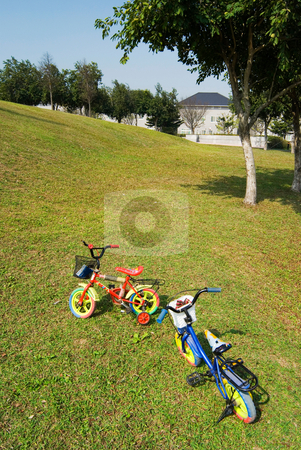 Child bicycle on the grass stock photo, Child bicycle on the grass by Lawren