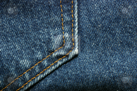 Jean or Denim Fabric stock photo, A detail of jean, denim material suitable for background. by Tom Weatherhead