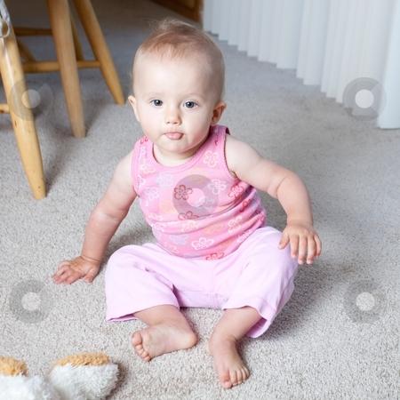 Floorplay stock photo, Cute Caucasian baby girl playing on a floor. by Mariusz Jurgielewicz