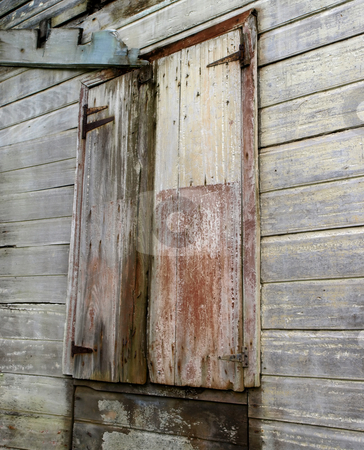 Weathered wooden barn doors stock photo, A pair of weathered and rustic wooden barn doors by Jill Reid