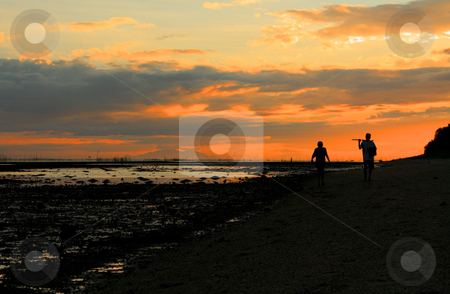 Father and son stock photo, Silhouette of a fisherman and his son walking on a low tide sea shore by Claro Alindogan