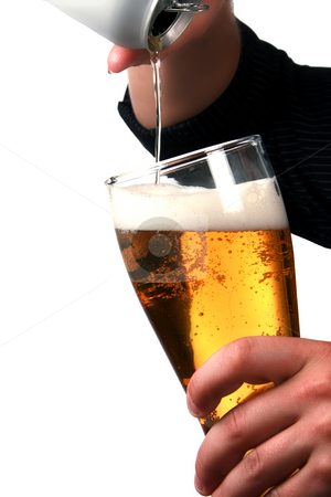 Pouring beer stock photo, Hands pouring beer into a stein. by Damien Richard