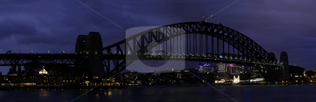 Sydney Harbour Bridge stock photo, The Sydney Harbour Bridge is a steel arch bridge across Sydney Harbour that carries rail, vehicular and pedestrian traffic between the Sydney central business district and the North Shore. The dramatic view of the bridge, the harbour, and the nearby Sydney Opera House is an iconic image of both Sydney and Australia. The bridge is locally nicknamed