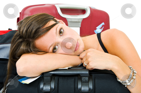 Tired traveller stock photo, Young woman, resting her head on a suitcase, weary from travelling by Corepics VOF