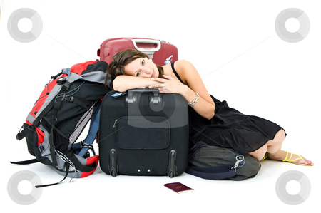 Weary traveller stock photo, Young woman resting on her luggage, weary from travelling by Corepics VOF