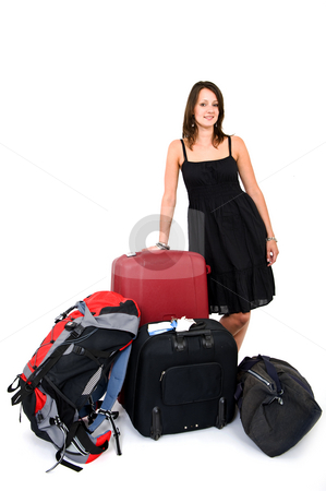 Happy traveller stock photo, Young smiling woman surrounded by luggage being a happy traveller by Corepics VOF