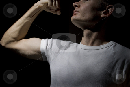 Dramatic power pose  stock photo, A man in a power pose, symbolising uprising or vengeance by Jandrie Lombard