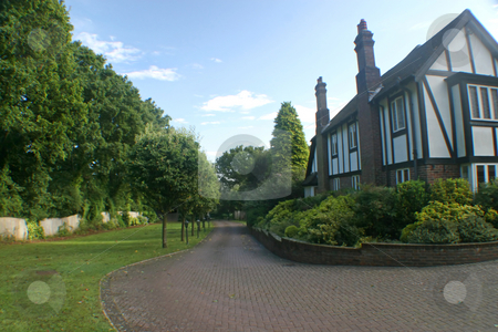 British Home Driveway stock photo, A driveway to a big tudor house in the UK. by Lucy Clark