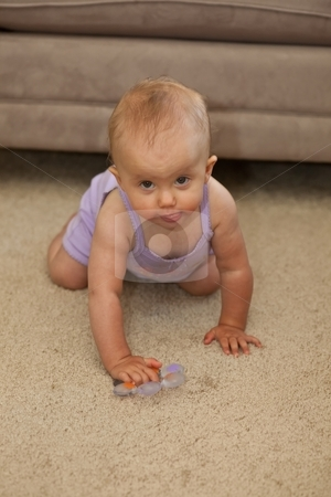 Floorplay stock photo, Cute Caucasian baby girl playing on a floor. by Mariusz Jurgielewicz
