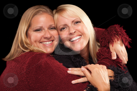 Two Beautiful Smiling Sisters Portrait stock photo, Two Beautiful Smiling Sisters Portrait Isolated on a Black Background. by Andy Dean