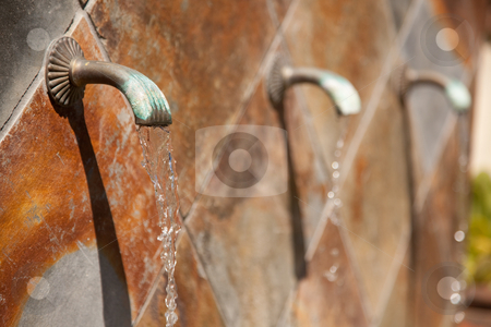 Stone Wall Fountain Abstract stock photo, Beautiful Stone Wall Water Fountain Row Abstract. by Andy Dean