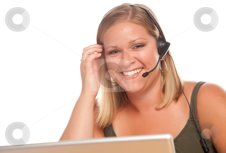 Attractive Customer Support Woman Smiles stock photo, Attractive businesswoman smiles as she talks on her phone headset. by Andy Dean