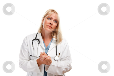 Concerned Female Blonde Doctor stock photo, Concerned Female Blonde Doctor or Nurse with Hands Folded Isolated on a White Background. by Andy Dean