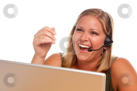 Attractive Customer Support Woman Laughs stock photo, Attractive businesswoman Laughs as she talks on her phone headset. by Andy Dean