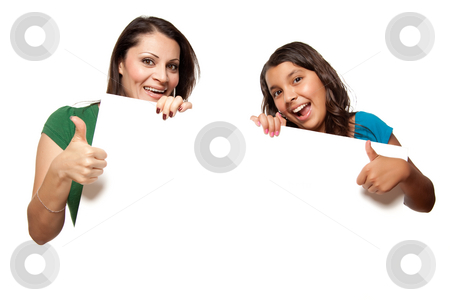 Pretty Hispanic Girl and Mother Holding Blank Board stock photo, Pretty Hispanic Girl and Mother Holding Blank Board Isolated on a White Background. by Andy Dean