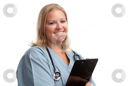 Friendly Female Blonde Doctor stock photo, Friendly Female Blonde Doctor or Nurse with Clipboard Isolated on a White Background. by Andy Dean