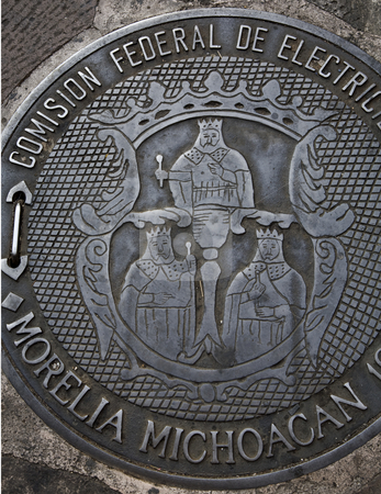Government Seal of Three Kings Morelia Mexico stock photo, Government Seal of Three Kings Morelia Mexico on man hole cover in Morelia Street by William Perry
