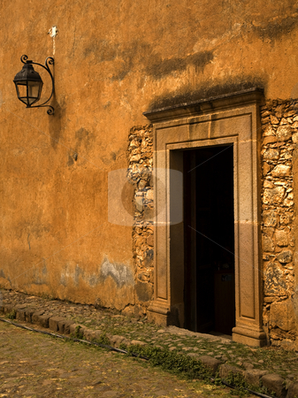 Yellow Brown Adobe Wall and Door Plus Lantern stock photo, Yellow Brown Adobe Wall and Door Plus Lantern Patzcuaro Mexico by William Perry