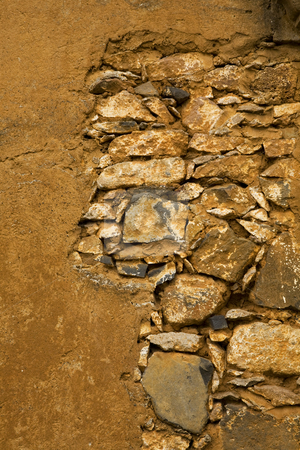 Yellow Brown Rocky Adobe Wall Mexico stock photo, Yellow Brown Rocky Adobe Wall, Patzcuaro, Mexico by William Perry