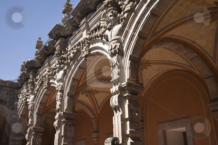 Courtyard Grey Scluptures Orange Arches Queretaro Mexico stock photo, Arches Sculptures Temple and Convent of Saint Agustin, Art Museum, Queretaro, Mexico, Details, Built 1745 by William Perry