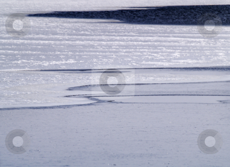 Frozen Lake stock photo, Lake covered with ice. by W. Paul Thomas
