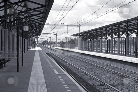 Railway Station (Monochrome) stock photo, Monochrome photo of a railway station in the Netherlands.  High contrast with a hint of a blue tint to make it look a little cooler. by Inge Schepers